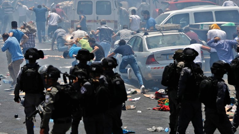Israeli peacekeepers clash with Palestinian demonstrators in Jerusalem. Photo courtesy of Getty Images.